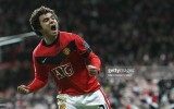 MANCHESTER, ENGLAND - DECEMBER 30: Rafael Da Silva of Manchester United celebrates his part in Wayne Rooney scoring their first goal during the FA Barclays Premier League match between Manchester United and Wigan Athletic at Old Trafford on December 30 2009 in Manchester, England. (Photo by John Peters/Manchester United via Getty Images)