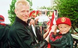 MANCHESTER, ENGLAND - MAY 1:  Peter Schmeichel of Manchester United celebrates winning the Premiership Title with his son, during the Homecoming Parade through Manchester on May 1, 1994.  (Photo by John Peters/Manchester United via Getty Images)